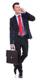 Business man with briefcase talking on the phone Stock Photography