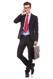 Business man with briefcase talking on phone Royalty Free Stock Photo
