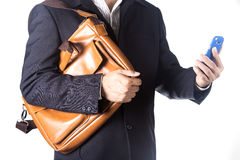 Business man with briefcase and using smartphone Royalty Free Stock Images