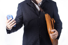 Business man with briefcase and using smartphone Stock Photo