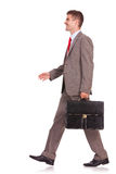 Business man with briefcase walking Stock Photo