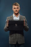Business man with briefcase Stock Photography