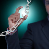 Business man with broken chain. In color background Royalty Free Stock Image