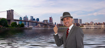Business man by the Brooklyn Bridge. With his thumb up Royalty Free Stock Photos