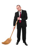 Business man with broom. Business man with a broom is cleaning the ground Royalty Free Stock Images