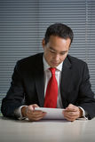 Business man browsing documents Stock Photo