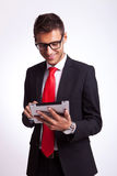Business man browsing on his new tablet pad Stock Photos