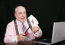Business man burning a check Stock Photos