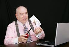 Business man burning a check Stock Photos