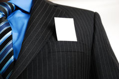 Business man with business card in the pocket Royalty Free Stock Photos