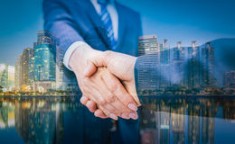 Business Man. Business handshake and business people on city Royalty Free Stock Photo