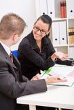 Business man and business woman Stock Images