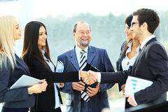 Business man and business woman shake hands Stock Image
