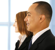 Business Man And Business Woman Smiling Stock Photography