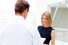 Business man and business woman to discuss reports Stock Photo