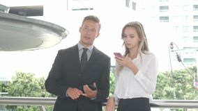 Business man and business women using smart phone, Business concept. stock video