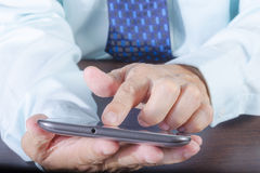 Business man. Businessman hand holding and using digital tablet Stock Image