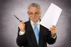 Business man. Businessman holding paper and pen Royalty Free Stock Image