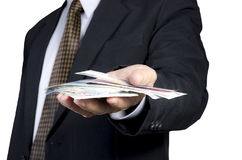 Business man. Businessman showing packs of international bank note Stock Photography
