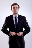 Business man buttoning his coat Royalty Free Stock Photo