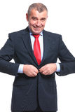 Business man buttoning his jacket Royalty Free Stock Photos
