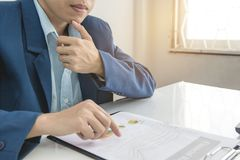 Business man calculate about cost and doing finance at office, Finance managers task,Concept business and finance investment Royalty Free Stock Photo