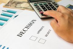 Business man calculate for decision on document with calculator, Royalty Free Stock Photography