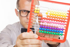 Business man calculating on abacus calculator Royalty Free Stock Images