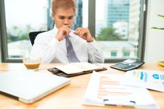 Business man calculating budget numbers, Invoices and financial. Adviser working Royalty Free Stock Image