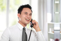 Business man calling. Handsome business man calling while working at the office Royalty Free Stock Photos
