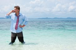Business man calling by cell phone on the beach Royalty Free Stock Photos