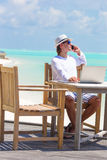 Business man calling by cell phone on white beach Royalty Free Stock Photo