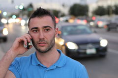 Business man calling by phone in front of city traffic jam blurred Stock Photos
