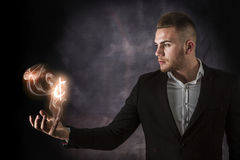 Business Man With Canadian Dollar on Fire Stock Images