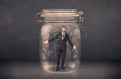 Business man captured in glass jar with hand drawn media icons c Royalty Free Stock Images