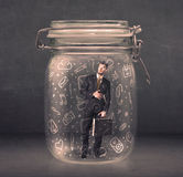 Business man captured in glass jar with hand drawn media icons c Royalty Free Stock Photo