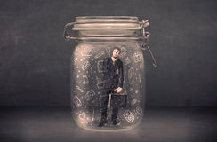 Business man captured in glass jar with hand drawn media icons c Royalty Free Stock Image