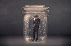 Business man captured in glass jar with hand drawn media icons c Stock Images