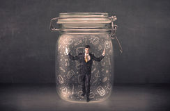 Business man captured in glass jar with hand drawn media icons c Stock Photography
