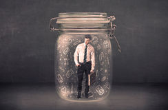 Business man captured in glass jar with hand drawn media icons c Royalty Free Stock Photography