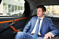 Business man in car. Business man goes to the executive car