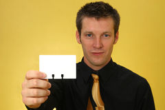 Business Man with Card Stock Photo