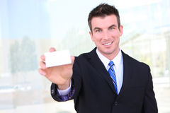 Business Man with Card Royalty Free Stock Image