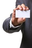 Business man card. A business man reaching his hand with business card Royalty Free Stock Photo