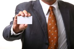 Business man card. A business man reaching his hand with business card Royalty Free Stock Photography