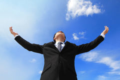 Business man carefree outstretched arms. With sky and cloud, asian people Royalty Free Stock Image