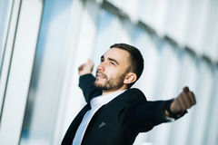 Business man carefree outstretched arms. Winner Royalty Free Stock Image