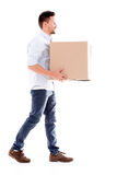 Business man carrying a box Royalty Free Stock Photography