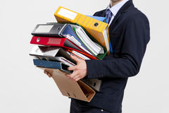 Business man carrying folders Royalty Free Stock Image