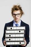 Business man carrying folders Stock Photos